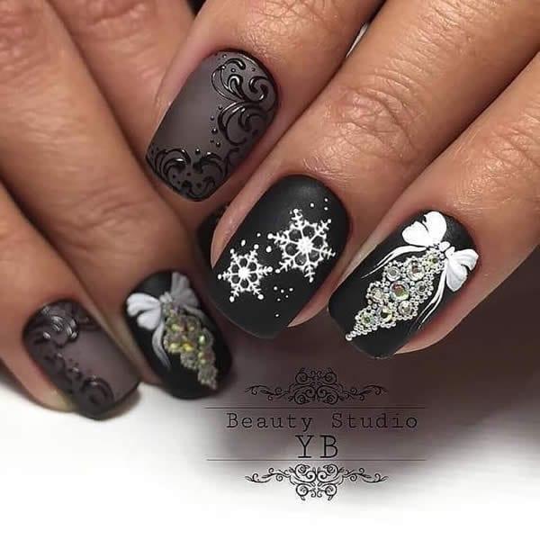 unhas decoradas com flocos de neve
