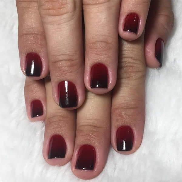 unhas decoradas vermelhas com degradê com preto
